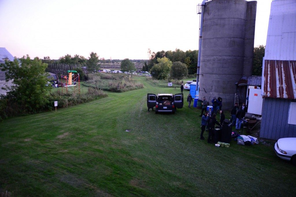 Cars and people behind the silo